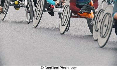 Marathon on the streets, disabled athletes in wheelchair...