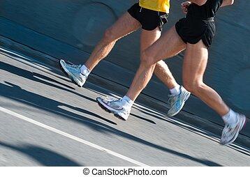 Marathon runners - Close-up of two marathon runners wth ...