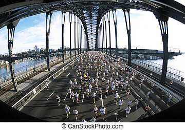 Marathon runners cross the Sydney Harbour bridge during the race.
