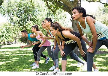Marathon runners preparing for a race