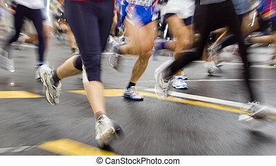 marathon - fast marathon runners slow sync close up shoot