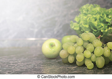 marble background with green grape