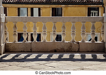marble balustrade with pillars and the shadow