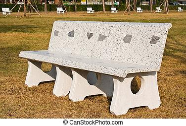 Marble garden chair on brown grass