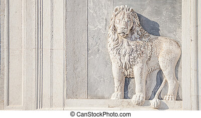 Marble lion on church facade