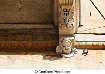 Marble Relief of Happy Face in Genoa, Italy