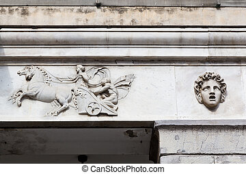 Marble Relief of Woman Driving Chariot in Genoa, Italy