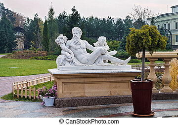 marble sculpture in the autumn park