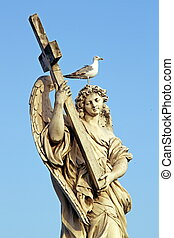 Marble statue of an Angel, in Rome, with cross and seagull