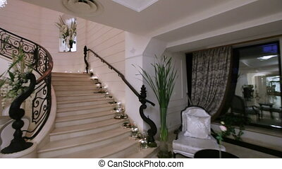 Camera on steadicam climbing marble staircase