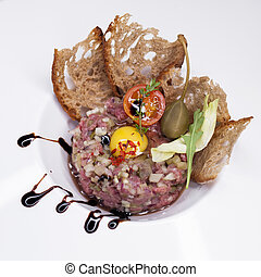 Marbled beef tartare on a white plate