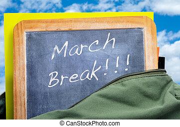 march break written in a blackboard in a school bag with books