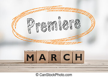 March premiere with a wooden sign