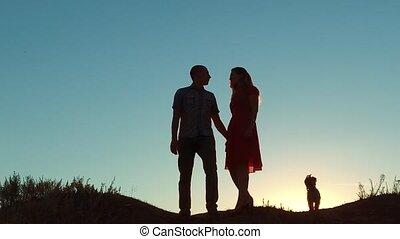 marche, concept, amour, aller, girl, lent, silhouette, soleil, ciel, jeune, tenue, heureux, course, nature, couple, main, dramatique, fond, video., homme, dog., style de vie, marche., light., chien, mouvement, coucher soleil, dehors, pour, amitié