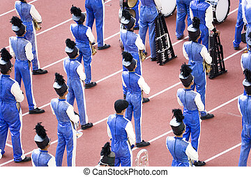 Marching Band - Boys marching band performing at a stadium...