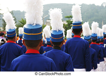 Marching band - Group of marching boys in blue and white...