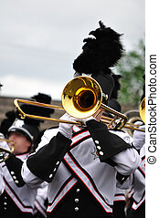 Marching Band Performer Playing Trombone in Parade, Copy...