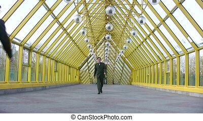 marching businessmen clones on bridge