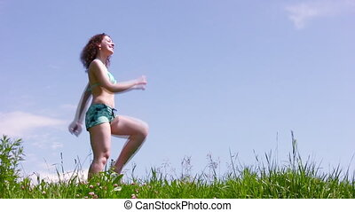 Marching woman on grass