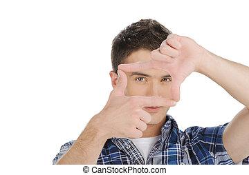 marco, marco, aislado, joven, Mirar, mientras, por, dedo, Elaboración, blanco, guapo, hombre