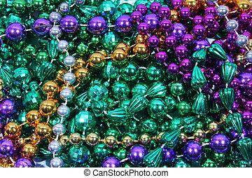 Mardi Gras Beads - Closeup of gold, green, and purple Mardi ...