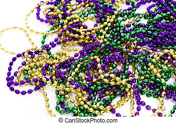 Mardi Gras beads on white backgound.