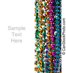 Mardi gras beads on white with copy space - Multi colored ...
