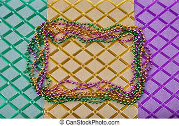 Mardi gras frame of three coulous beads on three colours glossy background