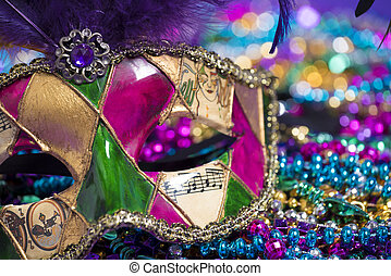 Mardi Gras Mask and beads - A venetian, mardi gras mask or...