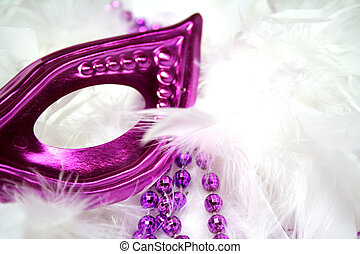 Mardi Gras Mask - Purple Mardi Gras mask and beads on white ...
