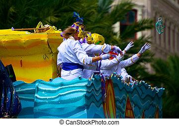 Mardi Gras parade throwing beads to crowd.