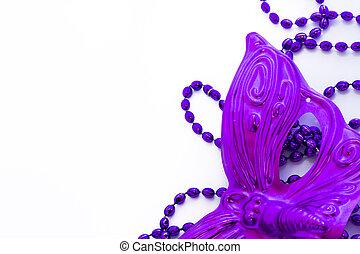 Mardi Gras purple beads and purple mask on white backgound.