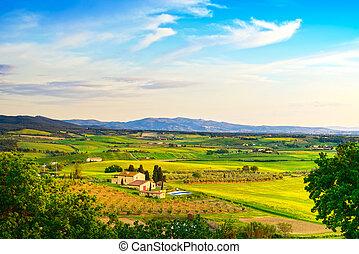 Maremma, rural sunset landscape. Countryside farm and green fiel