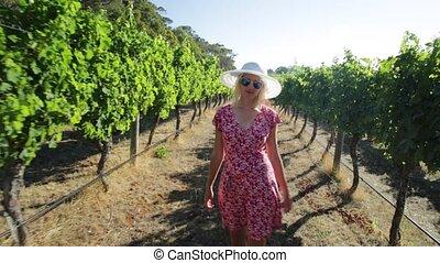Margaret River Woman enjoys - Australian vineyard...