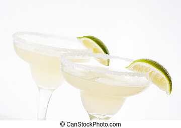 Margarita cocktails with lime in glass isolated on white background.
