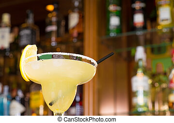 Margarita glass against the background of bar shelves
