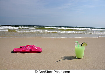 Margarita on the Beach - Margarita and flip flops on the...
