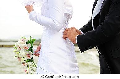 mariée, serrage, corset, mains