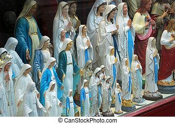 A lot of maria statues in a shop in the pelgrims village of Scherpenheuvel (Belgium)