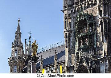 Marian column of Munich and the Glockenspiel at Marienplatz, Germany, 2015