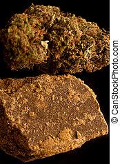 Marijuana and Hashish isolated on a black background.