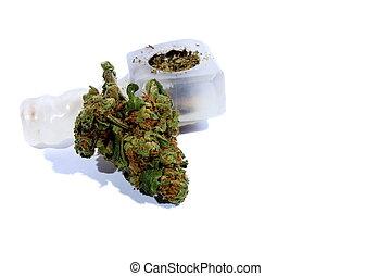 Marijuana and Pipe - Isolated marijuana bud laying by a...