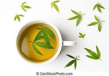 Marijuana herbal tea and cannabis leaves - Marijuana herbal...