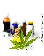 Marijuana leaf and cannabis oil bottles isolated