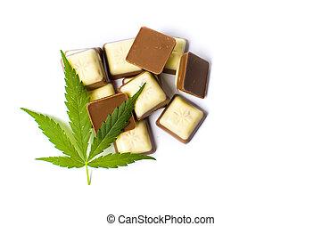 Marijuana leaf on top of chocolate pieces