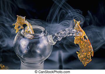 Marijuana oil concentrate aka shatter isolated with glass rig