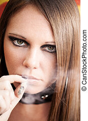 portrait of young female smoking a joint.