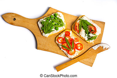Marijuana sandwiches with vegetables on a cutting board