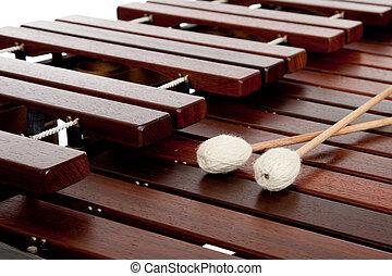 Marimba with mallets - A percussion instrument the marimba...