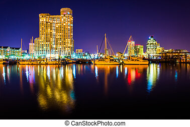 Marina and apartment building at night in Baltimore, Maryland.